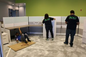 team members install cubicles