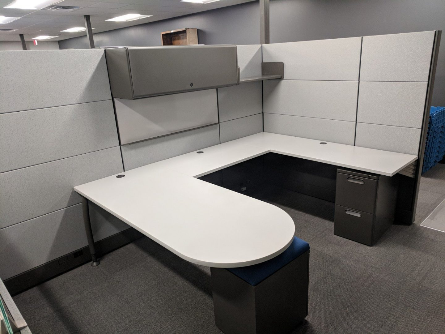 cubicle with a u-shaped desk