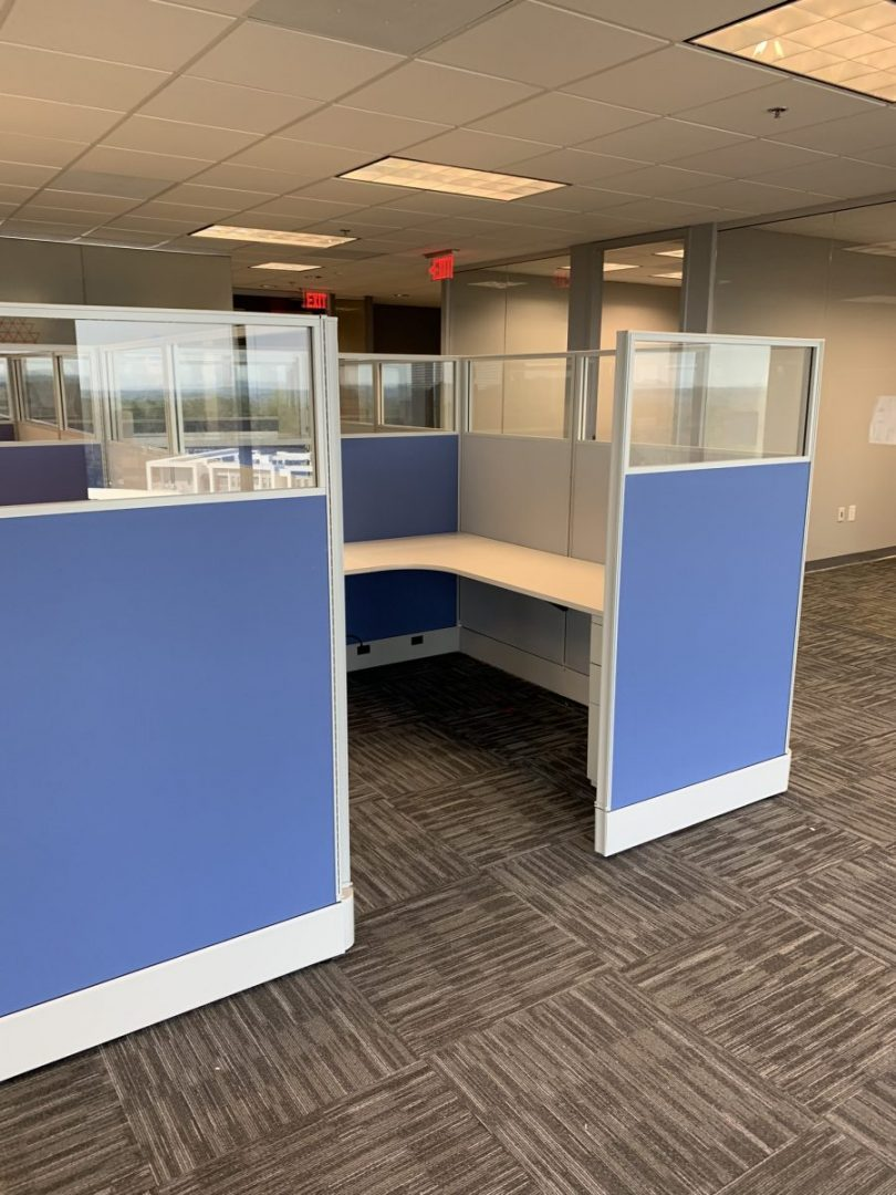 office cubicle with blue walls